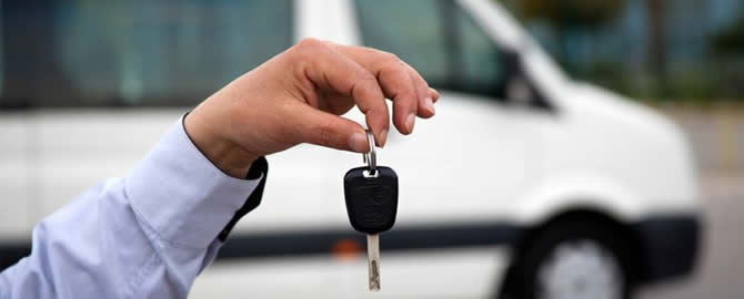 Person holding a key for a minibus