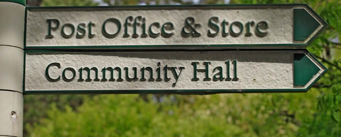 Signpost to community hall